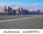 urban road asphalt pavement and ... | Shutterstock . vector #1163693971