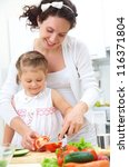 mother and daughter in kitchen... | Shutterstock . vector #116371804