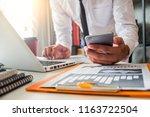 business hand using smart phone ... | Shutterstock . vector #1163722504