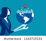 organization holds the globe.... | Shutterstock .eps vector #1163725231