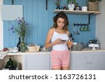 a woman uses a smartphone in... | Shutterstock . vector #1163726131