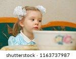 pensive girl sitting near of... | Shutterstock . vector #1163737987