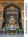 Small photo of Rome, Italy, 07/21/18: View of main altar in the Basilica of San Lorenzo in Lucina in Rome
