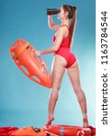 Lifeguard With Rescue Tube Buoy....