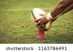 Rugby Player Preparing To Kick...