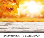 wood table top on shiny bokeh... | Shutterstock . vector #1163803924