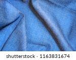 texture jeans background.... | Shutterstock . vector #1163831674