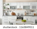 stylish kitchen interior with... | Shutterstock . vector #1163849011
