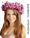 Beautiful brunette in a wreath of chrysanthemums - stock photo