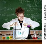 Small photo of Laughing mad professor combines some liquids in his laboratory