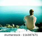 young man looking at sea from... | Shutterstock . vector #116387671