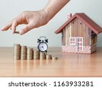 hand stacking coin and wooden... | Shutterstock . vector #1163933281