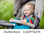 baby boy in warm colorful...   Shutterstock . vector #1163976274