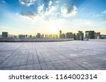empty square with city skyline | Shutterstock . vector #1164002314
