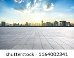 empty square with city skyline | Shutterstock . vector #1164002341