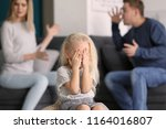 sad little girl in room with... | Shutterstock . vector #1164016807