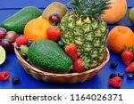 mix of healthy fresh fruits in... | Shutterstock . vector #1164026371