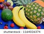 heap of healthy fruits on blue... | Shutterstock . vector #1164026374
