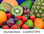 close up of assorted fruits... | Shutterstock . vector #1164027391