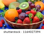 mix of colorful fruits in a... | Shutterstock . vector #1164027394
