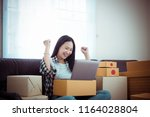 young woman online seller owner ... | Shutterstock . vector #1164028804
