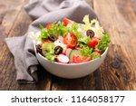 bowl of vegetable salad | Shutterstock . vector #1164058177