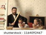 teacher and schoolgirls on... | Shutterstock . vector #1164092467