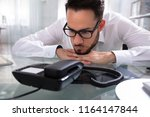 young businessman waiting for a ... | Shutterstock . vector #1164147844