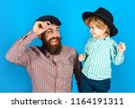 happy father and son in hats.... | Shutterstock . vector #1164191311