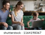 amazed excited son happy to... | Shutterstock . vector #1164198367