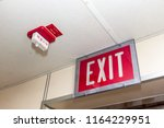 red fire alarm switch on the... | Shutterstock . vector #1164229951