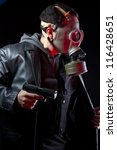 armed man with gas mask and gun | Shutterstock . vector #116428651