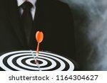dart target with arrows  image... | Shutterstock . vector #1164304627