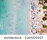 aerial view of a white beach... | Shutterstock . vector #1164320107