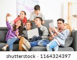 group of teenagers with modern... | Shutterstock . vector #1164324397