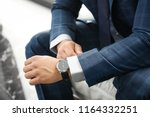young man in elegant suit... | Shutterstock . vector #1164332251