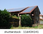 Solar panels on the roof of a farm for ecologic energy - stock photo