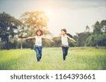 two little cute girls are... | Shutterstock . vector #1164393661