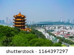 Yellow crane tower and Wuhan Yangtze Great Bridge scenic view in Wuhan Hubei China