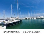 yachts in the harbor on a sunny ... | Shutterstock . vector #1164416584