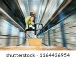 warehouse worker are dragging... | Shutterstock . vector #1164436954