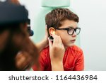 young boy at medical... | Shutterstock . vector #1164436984