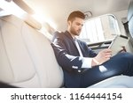 portrait of   businessman using ... | Shutterstock . vector #1164444154