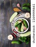 traditional cucumber in... | Shutterstock . vector #1164444661