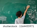 young asian male student... | Shutterstock . vector #1164455971