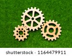 wooden gears on a background of ... | Shutterstock . vector #1164479911