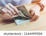woman's hand counting money 100 ... | Shutterstock . vector #1164499504