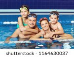 a happy family is smiling in a... | Shutterstock . vector #1164630037