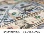 a pile of one hundred us... | Shutterstock . vector #1164666937