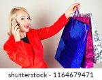 beautiful blonde female... | Shutterstock . vector #1164679471